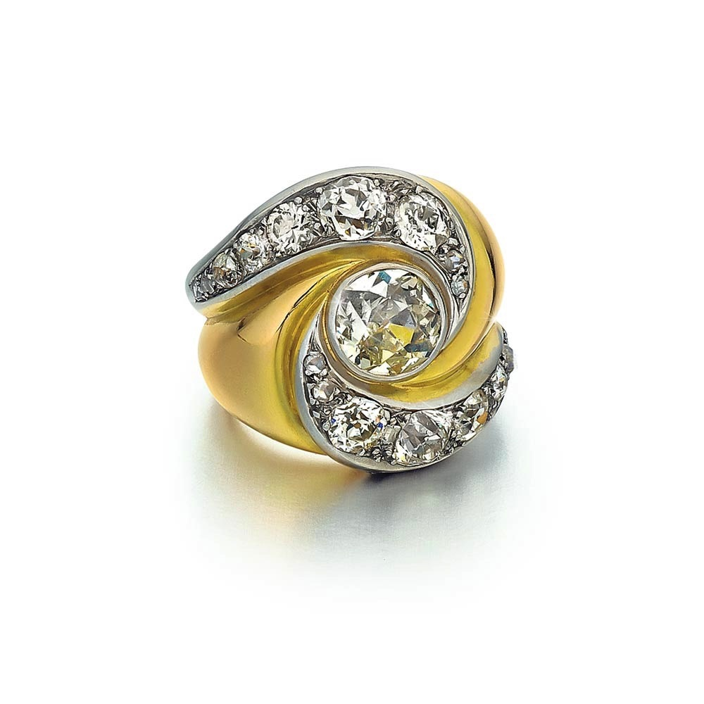 "A Platinum, Gold and Diamond ""Heureux"" Ring"