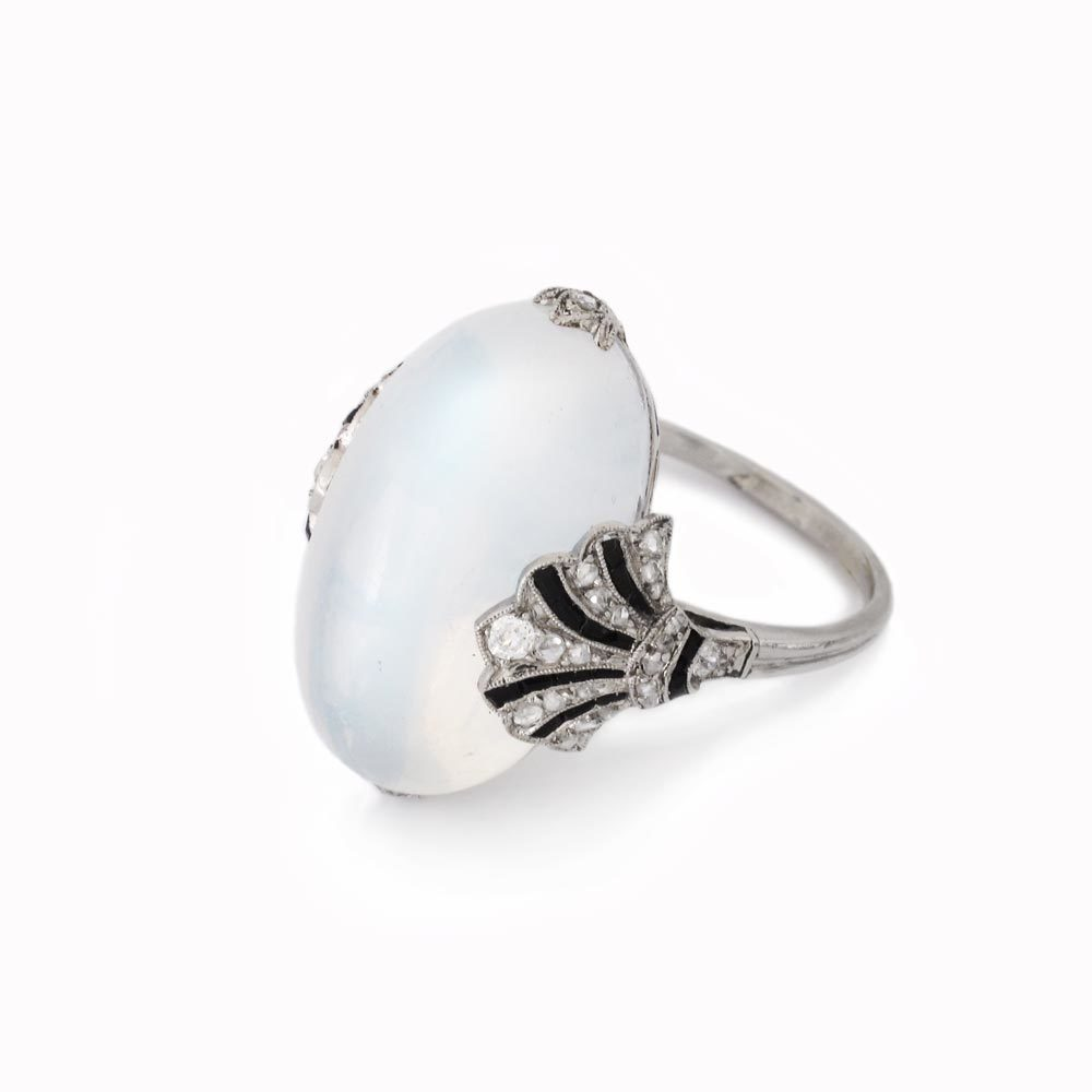 An Art Deco French Moonstone, Diamond and Onyx Ring