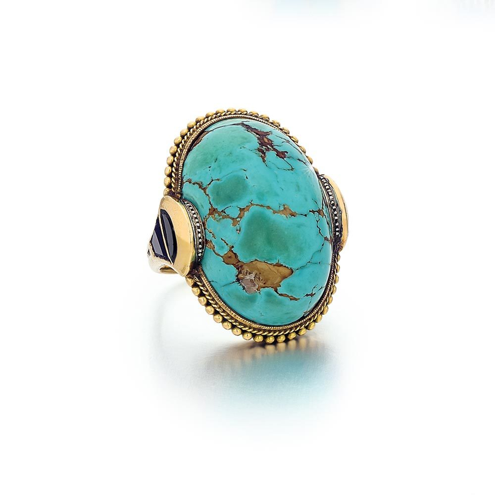 An Egyptian Revival Turquoise, Onyx, and Gold Ring