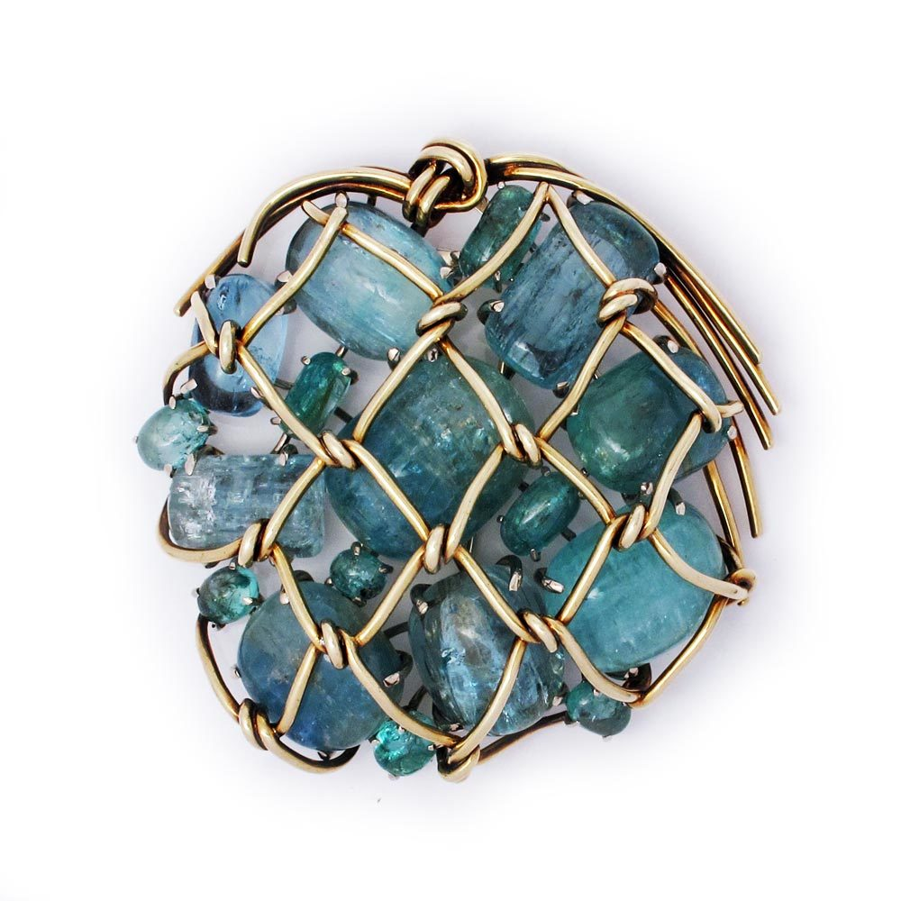 A Gold, Aquamarine and Emerald Brooch