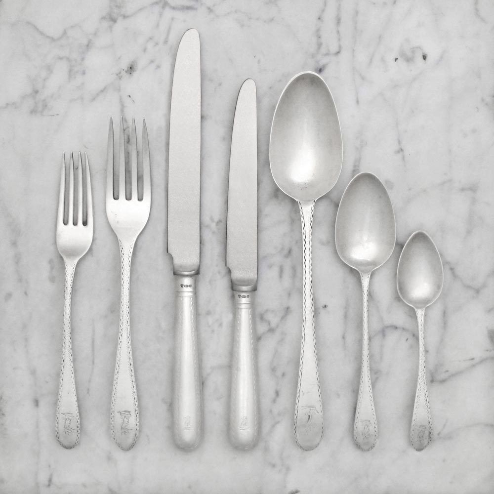 A George III Antique Irish Silver Bright Cut Pattern Flatware Service for Twelve
