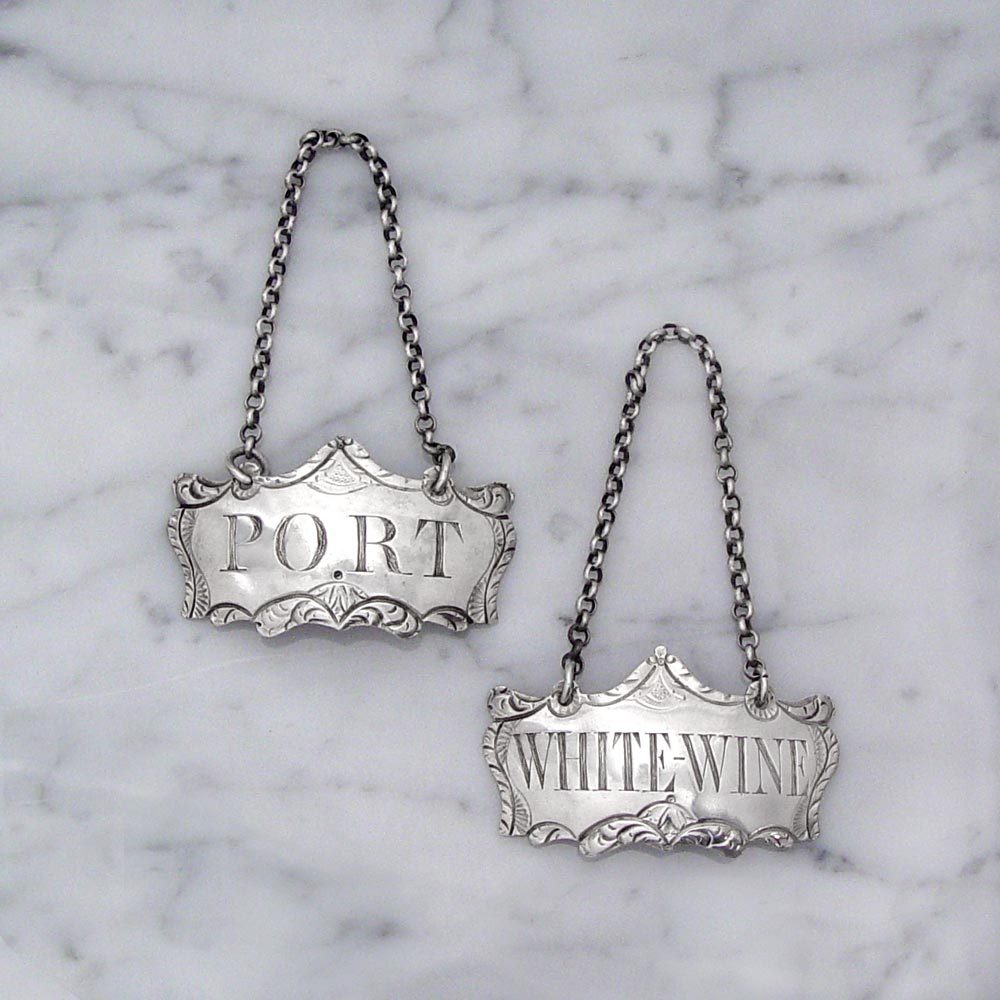 A Pair of George III English Silver Wine Labels by Hester Bateman