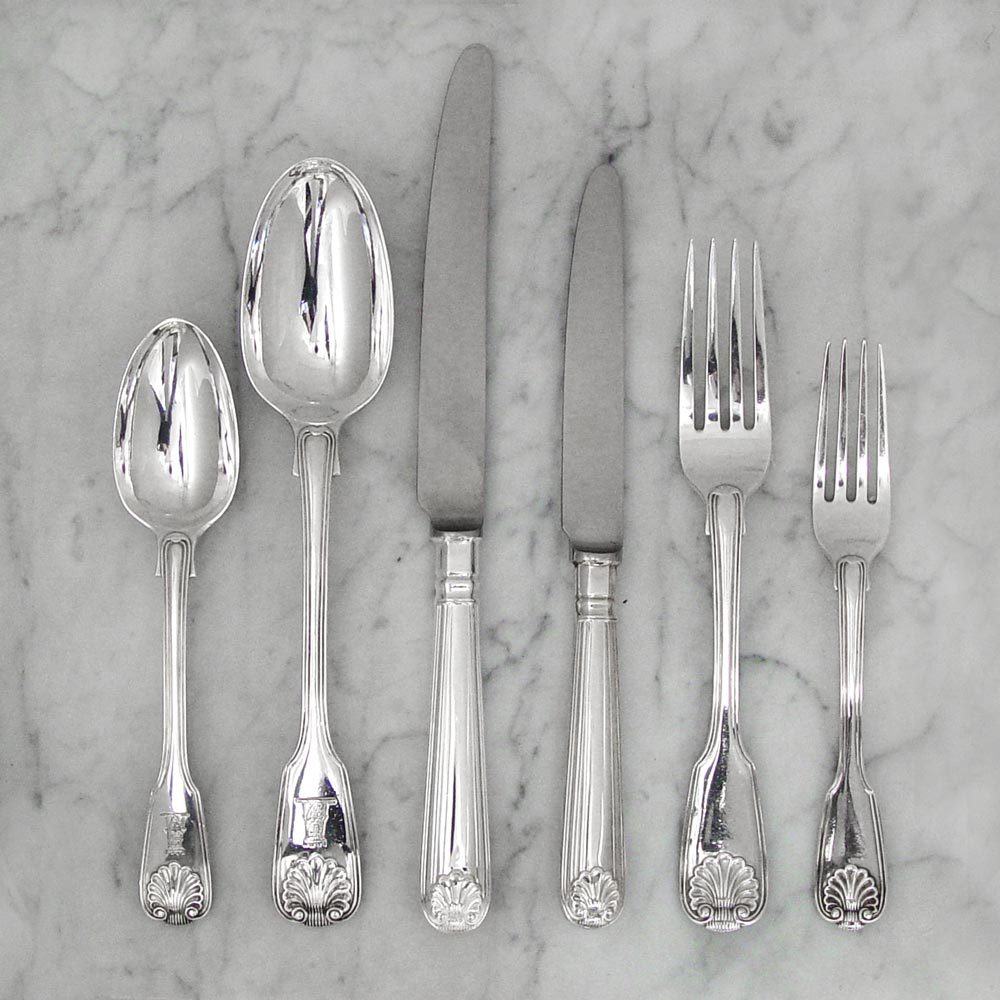 A George IV Antique English Silver Fiddle, Thread & Shell Flatware Service for 12