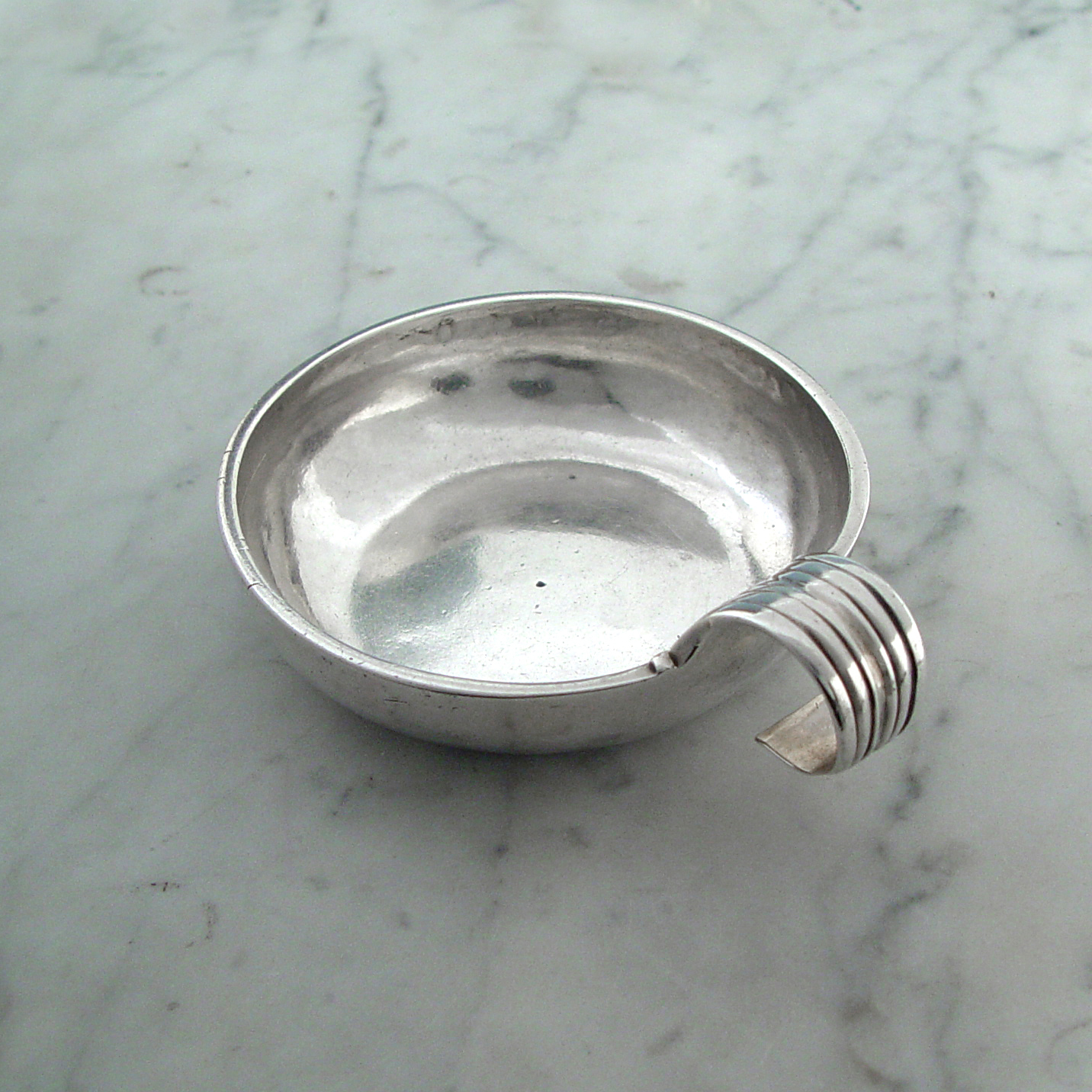 An Antique French Silver Wine Taster