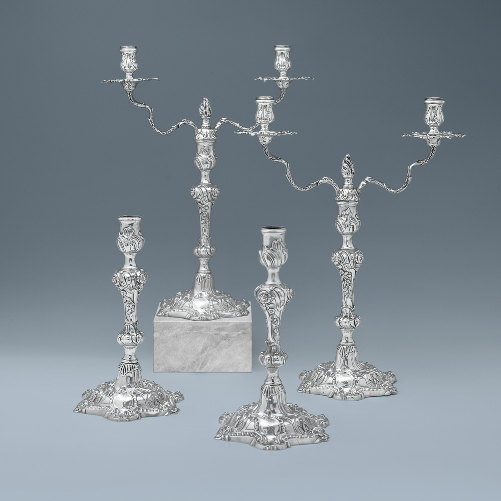 A Rare Suite of George II Antique English Silver Candlesticks