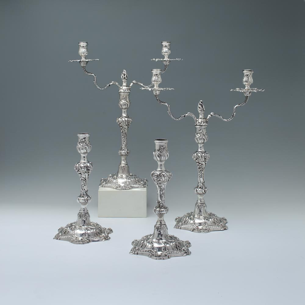 A Suite of George II Antique English Silver Candelabra and Candlesticks