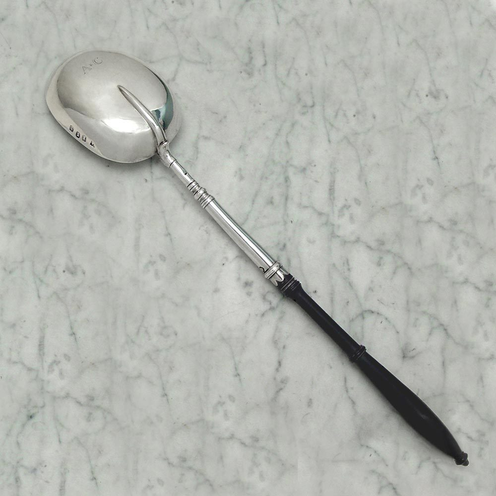 A Queen Anne Antique English Silver Basting Spoon