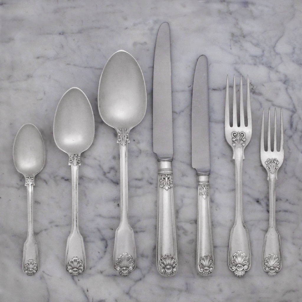 A Victorian Antique English Silver Flatware Service for Twelve