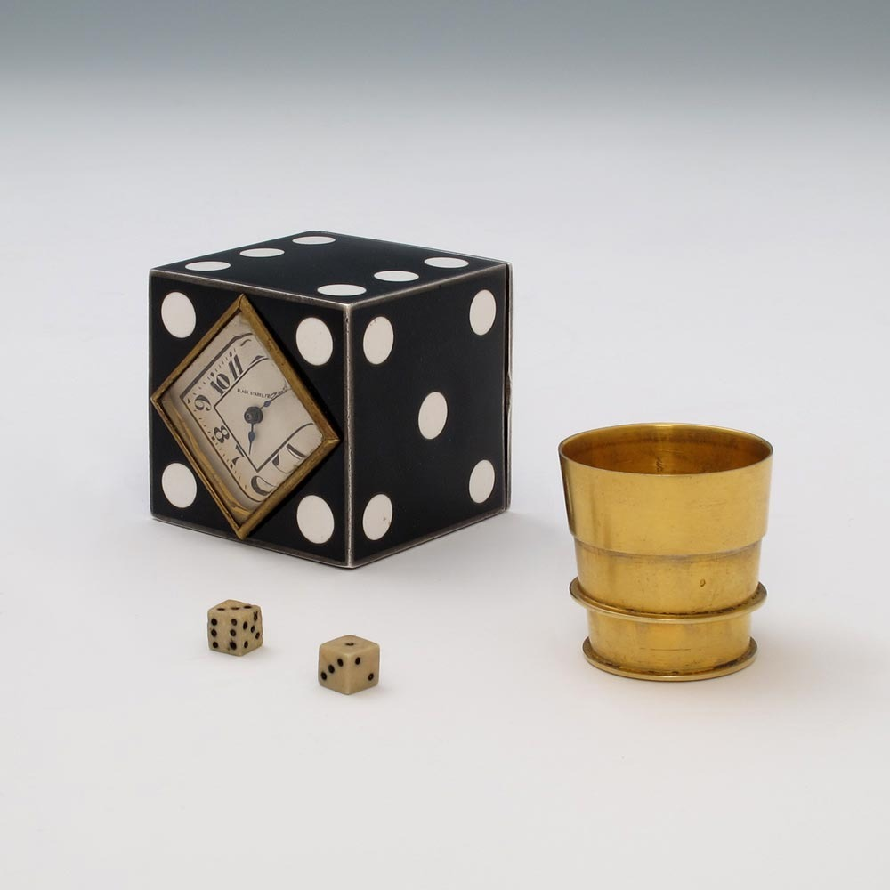 An American Art Deco Traveling Clock and Dice Set