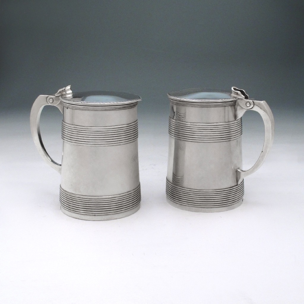 A Pair of George III Antique English Silver Tankards
