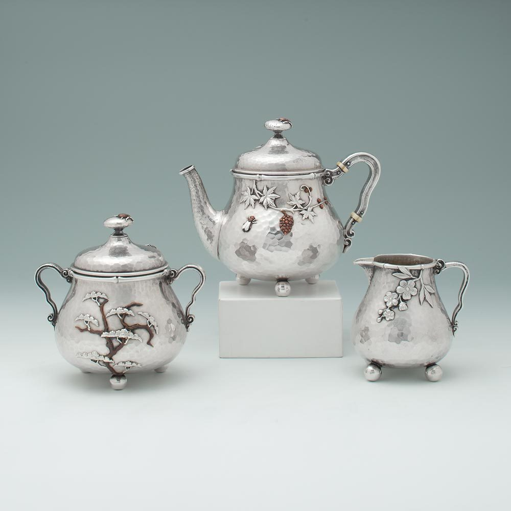 An Antique American Japanisme Mixed Metals Three Piece Tea Service