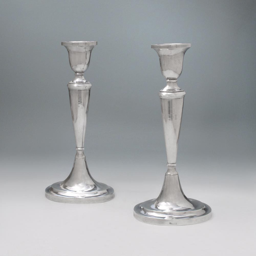 A Rare Pair of Early American Silver Candlesticks