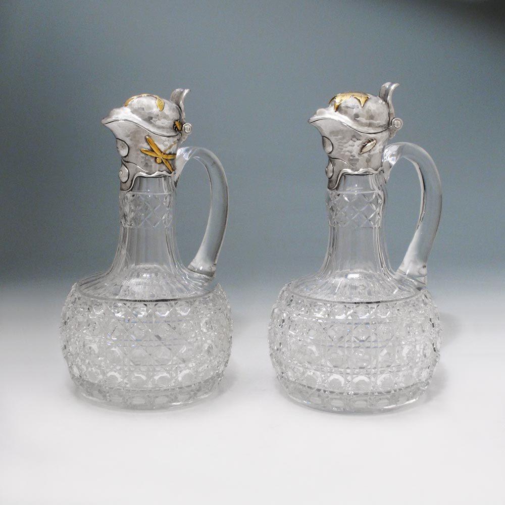 A Pair of American Mixed-Metal Silver-Mounted Claret Jugs