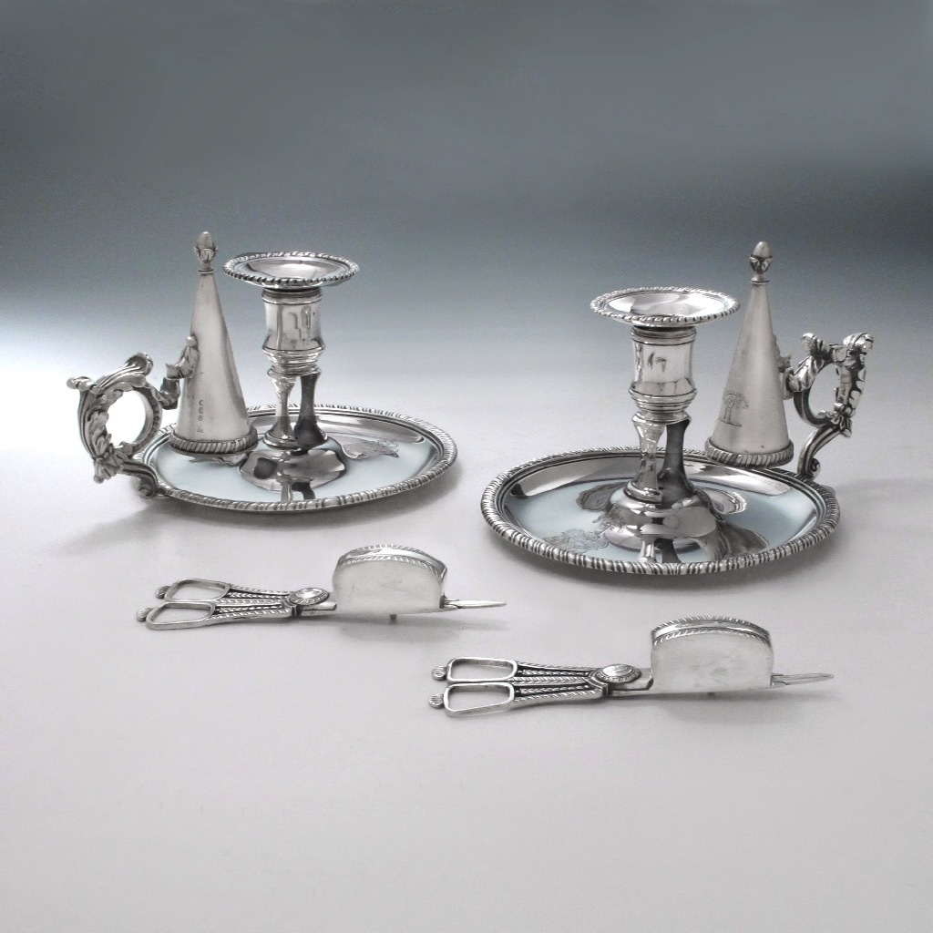 A Pair of George III Antique English Silver Chambersticks
