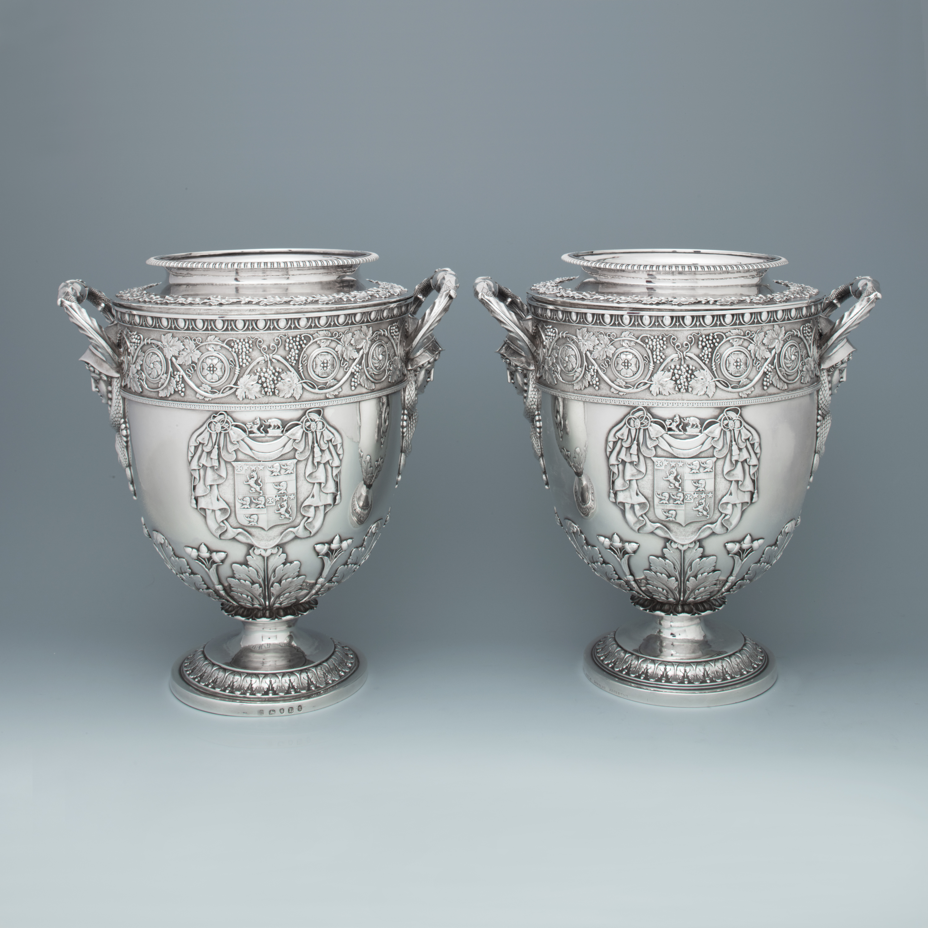 A Pair of George III Antique English Silver Wine Coolers