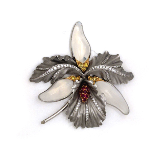 A Platinum, Moonstone and Ruby Brooch